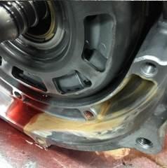 When radiator leaks antifreeze into transmission fluid, it turns tan or pink